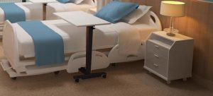 Billede af højdejusterbart sengebord med gråt stel, Sleep'n'Eat